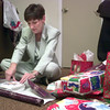 12-23-99---Hope Haven director Jalaane Ray wraps gifts for the home Thursday afternoon at the home. Kevin GReen