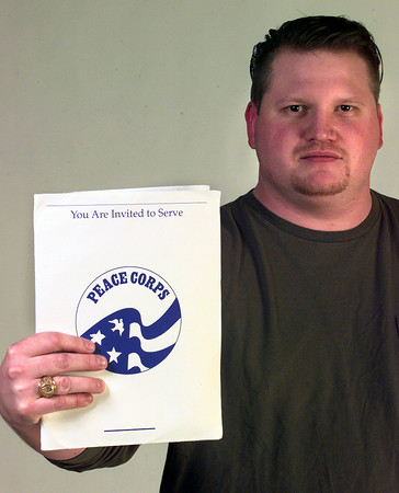12-28-99---Ken Beishir holds his packet for the Peace Corps Tuesday afternoon at the LNJ studio in Longview. Kevin GReen