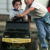 12/8/99---Alex Garcia, 8, pushes his brother John in a toy truck in front of their house on 12th Street in Longview as they played Wednesday with their sisters. bahram mark sobhani