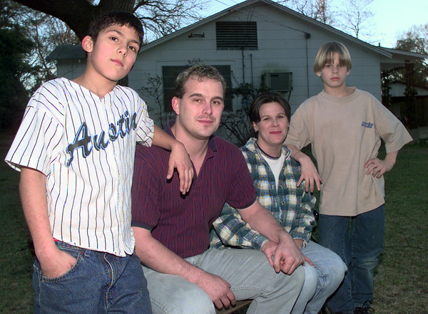 12-17-99---Left to right---Aaron Minnis, 11, Gary Minnis, Kelli Minni, Hayden Matlock,10, and not pictured is daughter Ivy Minnis,10, in thier home in White Oak. Kevin Green