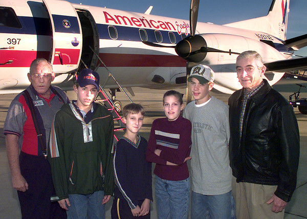 12-15-99--Left to Right----American Eagle Airlines INC. general manager Foy Belvins, left, Cody James, Zackary Dobbs, Cecellia Smith, Richard Hill, and Dr. Everett Ellin with the airport task force in front of an American Eagle plane, Kevin Green
