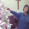 12-10-99---Willie Buck, looks at the Christmas tree at Crossroads United Methodist CHurch in Monroe addition on Texas FM 1249. The tree's ornaments include 80 symbols of Christ. Kevin Green