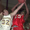 12/17/99---Pine Tree's (32) and Kilgore's (25) fight for a rebound in the second quarter of their game Friday at Pirates' Gym. bahram mark sobhani