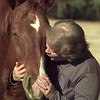 12/31/99---Ruth Meadows kisses her horse Hot Stuff at her home in Glenwood Acres. Meadows is executive director of Safe Haven, a rescue and retirement home for abused, unwanted and abandoned horses. bahram mark sobhani