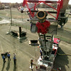 12/1/99---Station Five firefighters extend the ladder on their new firetruck as they train Tuesday at the LFD training grounds. The trucks ladder telescopes to 75 feet, giving firefighters the capacity to reach the top of a five-story building. The nozzle at the top of the ladder can output up to 1000 gallons of water per minute. bahram mark sobhani