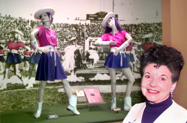 "12-21-99---Former Kilgore College Rangerette  Murlene ""Pinky"" Gattis Swingler poses in the Rangerette Museum in front of the uniform comparision between 1940 and today. Kevin GReen"
