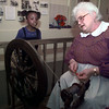 12/4/99---Margaret Minton explains the process and need for spinning wool to Crystal Tisdell, 8, of Longview, during the Gregg County Museum's Living History Christmas Saturday. bahram mark sobhani