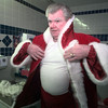 12/10/99---Kenneth Eddy dresses up to play Santa at Longview Mall. Eddy's dressing room and office is housed in a mall restroom. bahram mark sobhani
