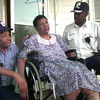 12-3-99---City of Longview workers Thomas Abston, left, and Tony Lewis, right, visit with resident Dorothy Bowens, center Frdiay afternoon at her home in Longview. Kevin Green