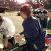 12-23-99---Jesus, left, and Claudia Butron, center, get a little help from Salvation Army volunteers Joseph Martinez, center right, and Brett Craig,14, right, while picking up Christmas gifts  Thursday morning in Longview. Kevin Green