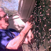 12-6-99--Harold Wright, replaces bulbs on his Christmas lights Monday afternoon in the 300 BLK. of Northwest Dr. in Longview. Special to the news-journal Austin Cochrum