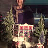 12/10/99---Cindy Bockman stands outside Headrick's of Texas storefront in Daingerfield, where her Snow Village display is set up. Bockman began her collection several years ago and after outgrowing her home, decided to moved it to the downtown shop. bahram mark sobhani