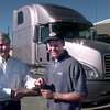 12-28-99---East Texas Mack Trucks president Bill Bankston, left, presents the keys to this Mack truck in background to Neal McCoy, right, Wednesday morning at ET Mack Truck in Gregg County. Kevin GReen