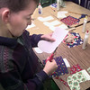 12-8-99---Joey Mars, a fourth-grader in Susan Lomanto's classroom cuts out material as they cover and decorate stockings for the angel tree at Haverty's, Thursday morning at Valley View Elementary in Longview. Kevin GReen