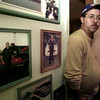 12/13/99---Gladewater police officer Bucky Goza stands next to pictures of him from his job in his home Saturday. Goza was suspended two days last week after two write-ups the same day. bahram mark sobhani