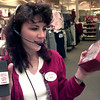 12-27-99---Target team relations leader and Y2K Captain, Cynthia Starr, talks on her walkie talkie as she answers a question Monday afternoon at Target in Longview. kevin GReen