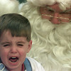12/10/99---Joshua Vance cries while on Santa's lap. bahram mark sobhani