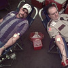 12/30/99---Gregg County Road and Bridge department worker Clay Graves, left, and Sheriff's Deputy John Dove, Jr. give blood Thursday at the Sheriff's office. bahram mark sobhani