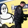 12-16-99---LPD officer Kirk Haddix fingerprints the door of the stolen hot air balloon trailer Thursday morning on Cox Diary Rd. in Gregg County. Kevin GReen