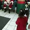12/10/99---Santa beckons a hesitant girl to tell him what she wants for Christmas. bahram mark sobhani