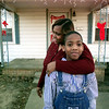 12/28/99---Terrance Sparkman stands outside his house with his mother, Aretha. Terrance was the first Longview baby born in the 1990s. bahram mark sobhani