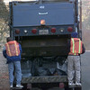 12-28-99---City of Longview trash men Marcus Polk, left, and Michael Champion, right, ride the trash truck while collecting garbage Tuesday morning in Longveiw. Kevin GReen