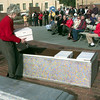 12-30-99---Alice Ward, with the One Hundred Acres of Heritage places a box in the time capsule duirng a ceremony Thursday morning at Heritage Plaza in Longveiw. Kevin GReen