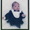 12/28/99---A portrait of Terrance Sparkman when he was one month old hangs on the wall of the Sparkmans' house. Terrance was the first Longview baby born in 1990. bahram mark sobhani