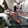 12/4/99---Ryan Brown, dressed in period clothing, stands over the electric train display at the Gregg County Museum Saturday during the Living History Christmas. bahram mark sobhani