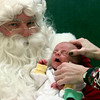 12/10/99---Santa waits as Ethan Blade Robinson's (1 month old) head is adjusted by his mom, Cinda, as Ethan has his picture taken with St. Nick at Longview Mall. bahram mark sobhani
