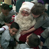 12/10/99---Santa is hugged from all sides after a Hallsville Pre-k class took a group picture. bahram mark sobhani