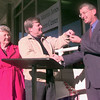 12-6-99---Paula Martin Jones mother Margaret Martin, left, looks on while her son Ruben Martin, center, hands over the keys to the Paula Martin Jones Recreation Center to City of Longview David McWhorter, right, during a ceremony Monday morning in Longveiw. Kevin GReen