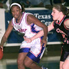 12-3-99--kilgore's #11, Kela Peterson, left, dribbles the ball as Connors State #12 Challah Coker, right, guards during a game Friday night at Lobo Coliseum in Longview. Kevin Green