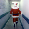12/10/99---Santa walks down the back corridor to his office for a break. Fifteen minute breaks amount to removing the hat and beard, but not much more, because about the time he takes them off, it's time to start getting ready to go back out. bahram mark sobhani