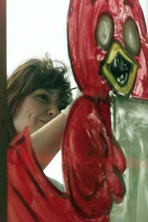 12/1/99---Tammy Hill of Diana paints a Christmas themed setting on the windows of ABC Auto Parts in Longview Wednesday. Hill said she paints the windows as a side business during the holiday season. bahram mark sobhani
