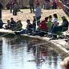 2/13/99--Fishing poles and line surrond the Teague Park Pond as Fidhing Day 99 got under way Saturday morning at Teague Park in Longview. Kevin green