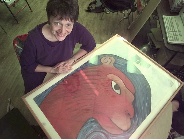 """2/4/99---Trinity School art teacher Ellen Herbert poses with a piece titled """"Hanuman"""" from her art series based on Hindu Mythology. Herbert will travel to India for a one-month stay as part of a Rotary exchange program. bahram mark sobhani"""