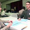 2/2/99--June Weems, left, a Longview realtor, judging the food marketing division, listens to Josh Harris, right, a LHS student and also works at Brookshires, during the DECA District 6 Career Conference Tuesday afternoon at Best Western in Longview. Kevin green