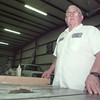 2/2/99---Panola College maintenance worker John Adams stands in the shop where a bulk of his work is done. Adams has served for more than 25 years at Panola College. bahram mark sobhani