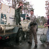 2/11/99--Left to Right----Genie Hilton, Texas Fish and Wildlife tech from Athens who brought the fish up, Gregg County game warden Sean Reneau, center and Texas district fisheries supervisor of Marshall Mike Ryan, right, release about 2,250 Rainbor Trout Thursday afternoon at Teague Park in Longview. Kevin green