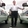2/11/99---Gene Noble owner of Noble Security stands with two of his security vehicles Thursday afternoon on Judson Rd. in Longview. Kevin Green