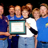 2/11/99--Ronnie Wilemon, left, maintenance and operations division supervisor presents a plaque to SWEPCO PR Becky McJunkins in center, and the Community Involment Committee during the Thursday evening at the city council meeting for thier donation time for improvements. JoLee Ferguson