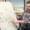 2/13/99---City Planner Randy Anderson points out on a map some possible problem areas for the new driveway ordinances Friday afternoon at City Hall in Longview. Kevin green