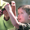 2/13/99---Jacob Vansickle,3, of Longview inspects one of the many fish caught duirng Saturday morning Fishing Day at Teague Park in Longview. Kevin Green