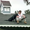 2/11/99---Drano hangs out on the roof with his owner Kirk Jenkins, on Dudley St. in Kilgore. Kevin green