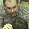 2/4/99---Clint Bruyere, DDS, checks the teeth of a young boy at the Longview Child Development Center Thursday morning. Bruyere and other representatives from the Gregg County Dental Society checked teeth and provide free toothbrushes and toothpaste. bahram mark sobhani