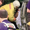 Date:   1/12/99---Longview Fire Department Lt. Pirkey pulls a victim out of his car while other officers stand ready to help after a car wreck on Mobberly Tuesday afternoon. Officers had to use the Jaws of Life to extract the victim.  Jessica Williamson