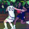 Date:   1/15/99---Gladewater's #? drives the ball down the court as White Oak's #20 plays defense. The Gladewater Lady Bears continue their undefeated reign by beating the White Oak Lady Roughnecks ----.  Jessica Williamson