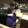 1/1/99---Newly elected judge Becky Simpson gets help with her robe from District Judge Alvin Khoury after he swore Simpson in Friday morning at the Gregg County Courthouse. bahram mark sobhani.