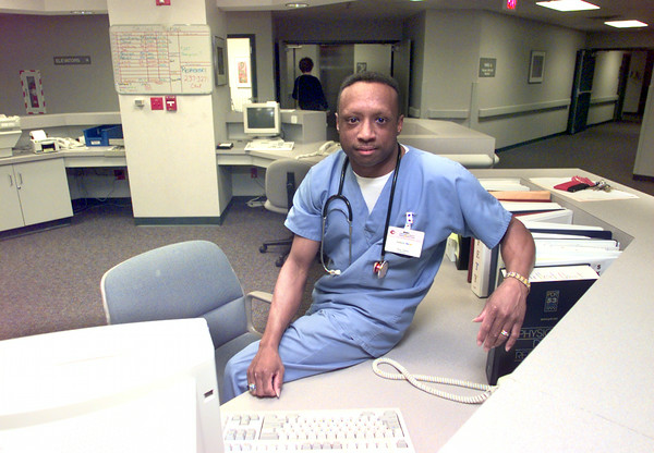 Date:   1/26/99---Anthony Harris at his nurses station at Longview Regional Medical Center. Kevin green